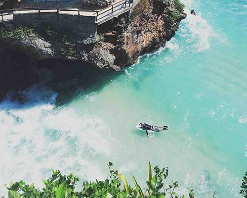 Uluwatu surfer in paradise