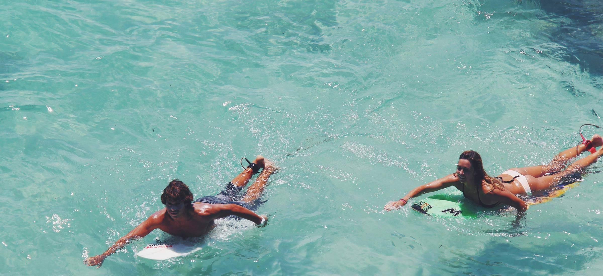surf-girl-couple-uluwatu-bali