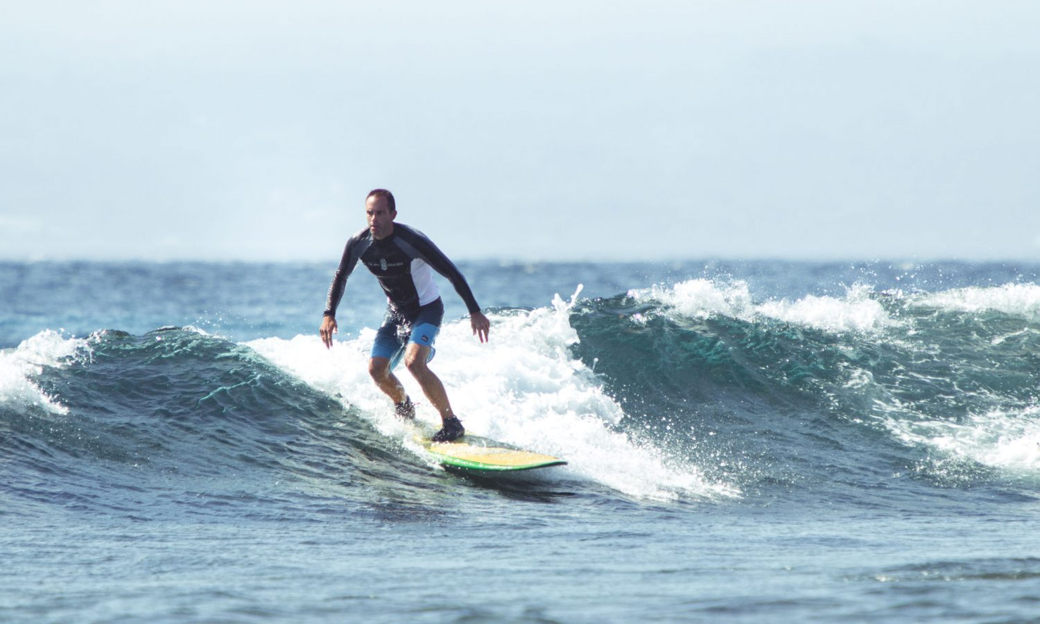 Male surfer attending surf coaching camp Bali