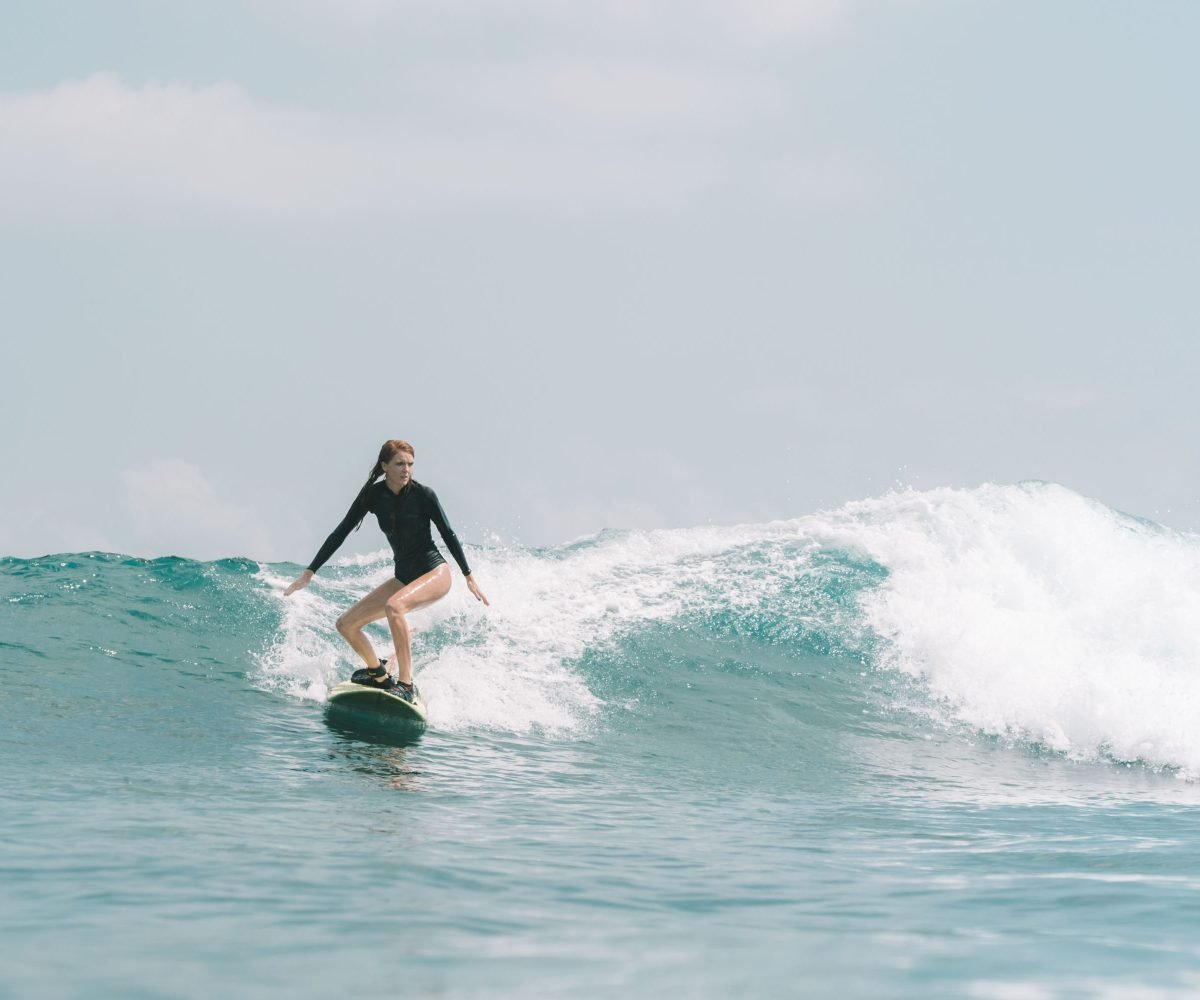 Beginner Female Surfer in Bali Learning to Surf at her Pace